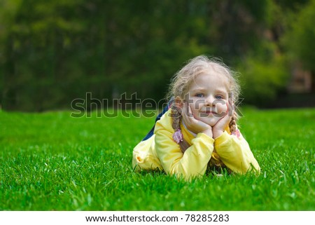 little girl playing on the playground - stock photo