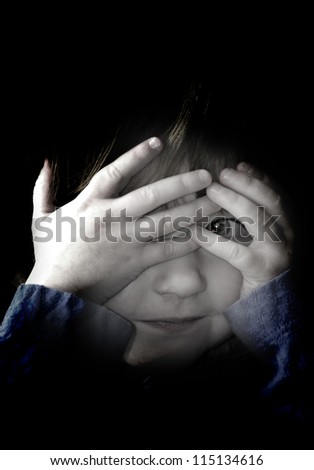 Little girl playing peek a boo with her hands