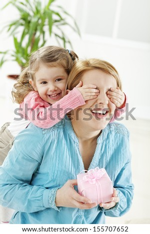 stock-photo-little-girl-playing-peek-a-boo-with-her-mom-155707652.jpg