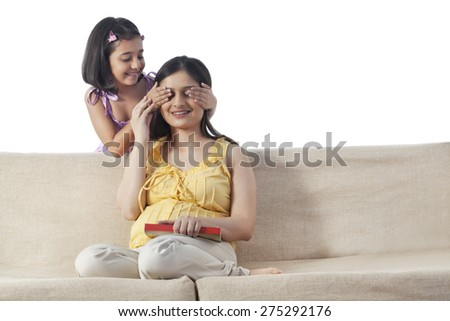 Little Girl playing Peek A Boo with her mother - stock photo