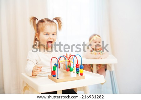 little girl playing the ape - stock photo