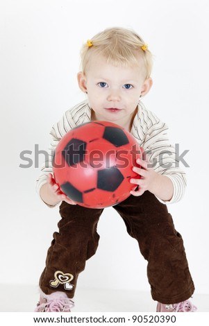 little girl playing with a ball - stock photo