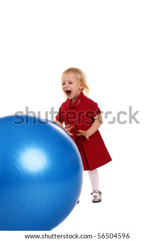little girl playing with a big ball