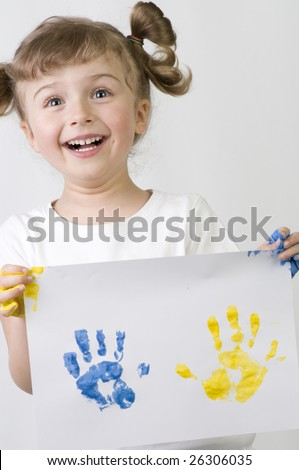 Little girl playing with colors - stock photo