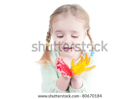 Little girl playing with colors