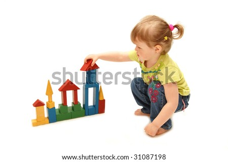 little girl playing with cubes
