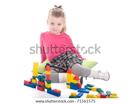 Little girl playing with cubes isolated on white background - stock photo