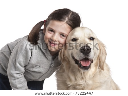Little girl playing with her dog golden retriever