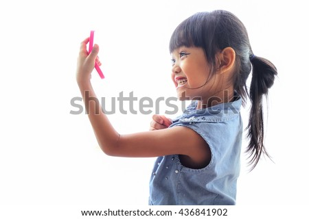 Little girl playing with makeup./ A little girl playing with cosmetics and make-up done themselves .