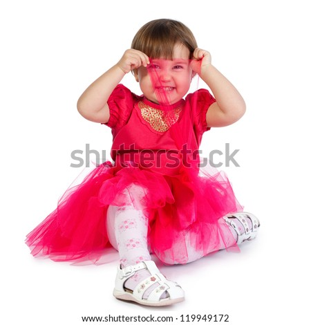 little girl plays hide and seek - stock photo