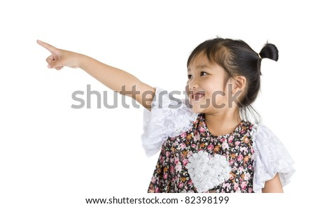 little girl pointing at something, isolated on white background - stock photo