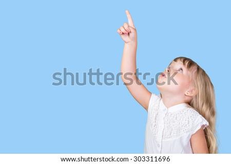 Little girl pointing finger - stock photo