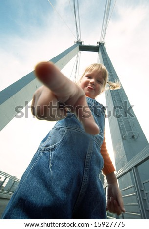 little girl poke finger and show tongue - stock photo