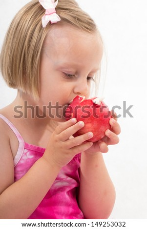 Little girl portrait eating red apple - stock photo