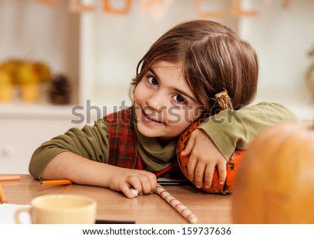 Little girl portrait in autumn - stock photo