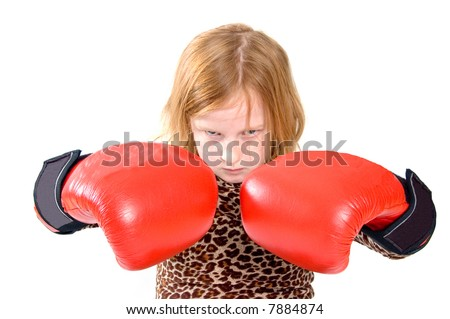 little girl portrait of a young girl with red boxing gloves - stock photo