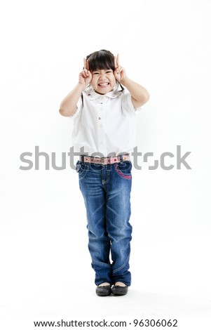 little girl portrait with white shirt and blue jean on the white background - stock photo