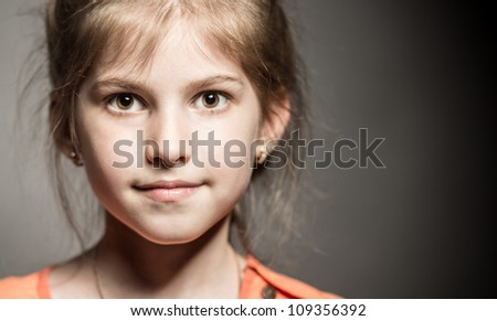 Little girl posing for her first model portfolio