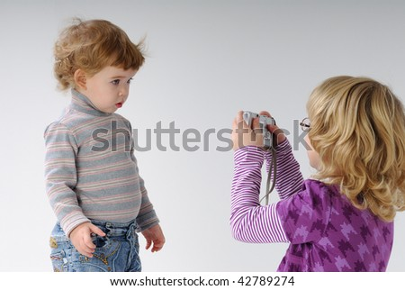 little girl posing for the camera - stock photo