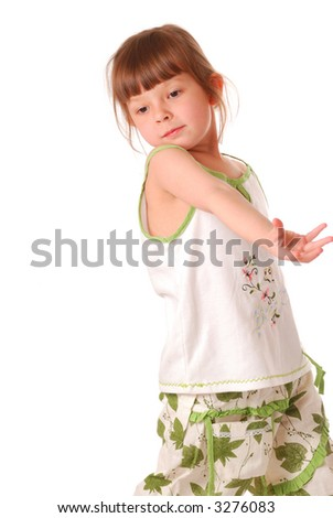 Little girl posing (isolated on white background) (word and figures on the t-shirt are not any kind of copyright subject)