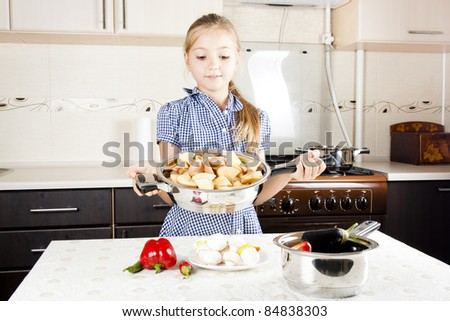 little girl preparing food in the kitchen