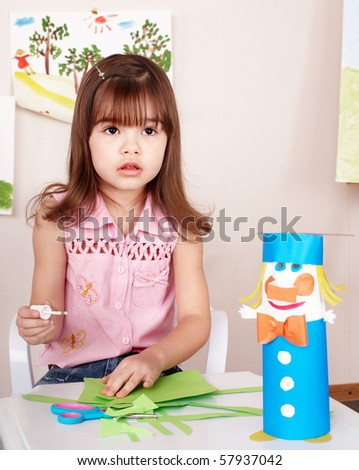 Little girl  preschooler play glue in classroom. - stock photo