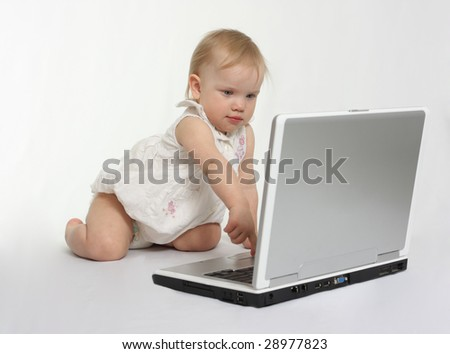 little girl pressing the button on the laptop