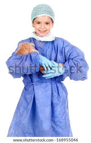 little girl pretending to be doctor - stock photo