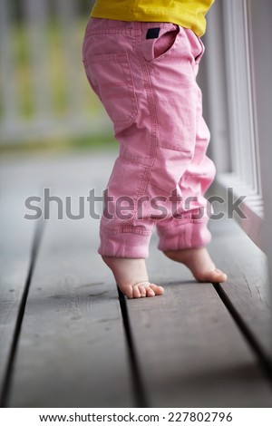 Little girl reaching up - stock photo