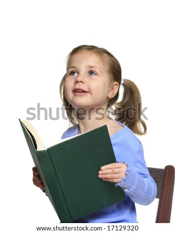 Little girl reading a book looking excitedly up at her teacher or parent - stock photo
