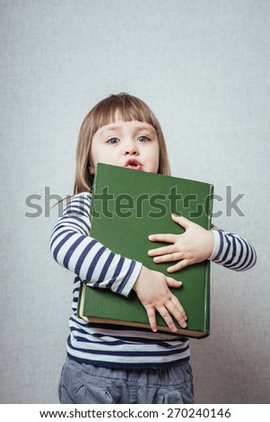 little girl reading book  - stock photo