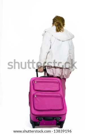 little girl ready to go on vacation - stock photo