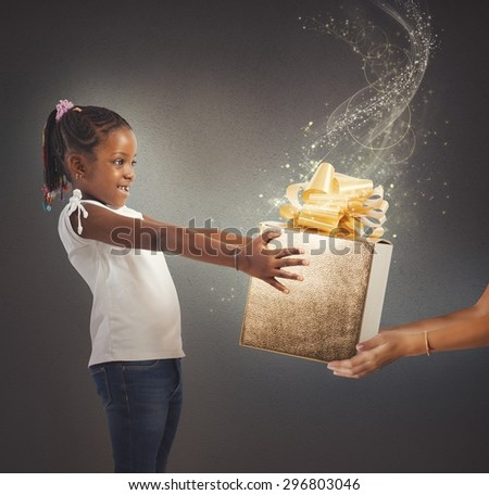 Little girl receives a magic present sparkling - stock photo