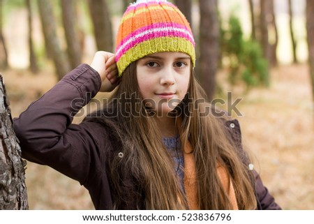 Little girl resting in forest