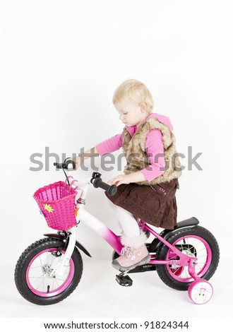 little girl riding bike - stock photo