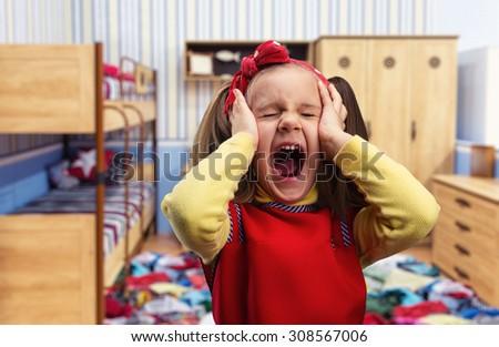 Little girl screaming - stock photo