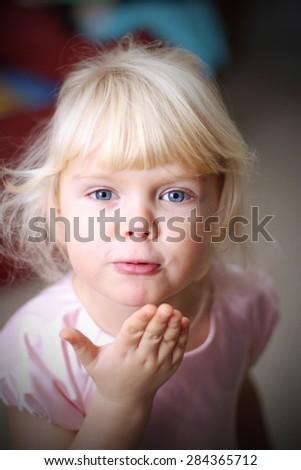 Little girl sends kiss - stock photo