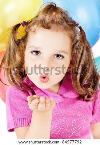 little girl sends kiss - stock photo