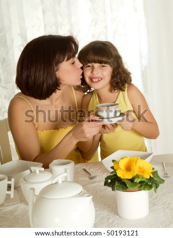 Little girl serving coffee for mother's day breakfast - stock photo