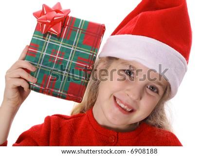 Little girl shaking present smile - stock photo