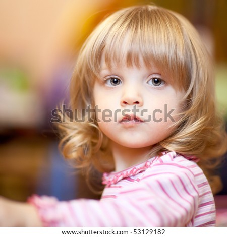 Little girl - shallow DOF, focus on front eye - stock photo