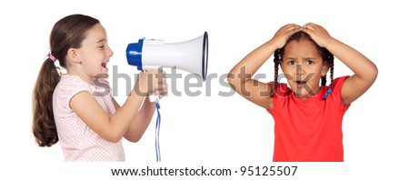 Little girl shouting through megaphone and a african baby isolated over white - stock photo