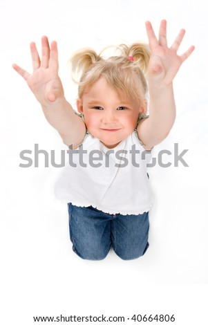 Little girl shows her hands, isolated on white - stock photo