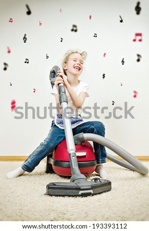 Little girl singing during cleaning the flat. Vintage Effect. - stock photo