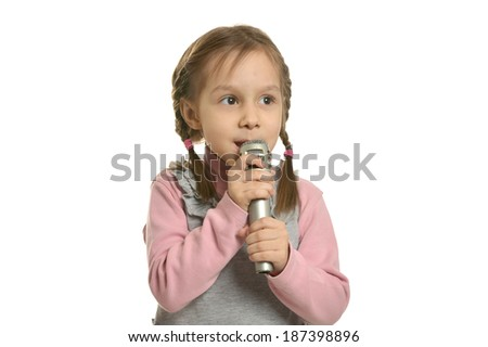 Little girl singing with microphone on a white background