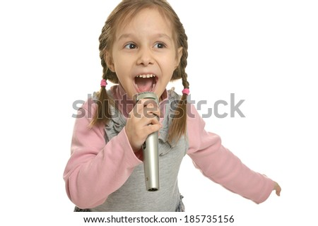 Little girl singing with microphone on white background - stock photo