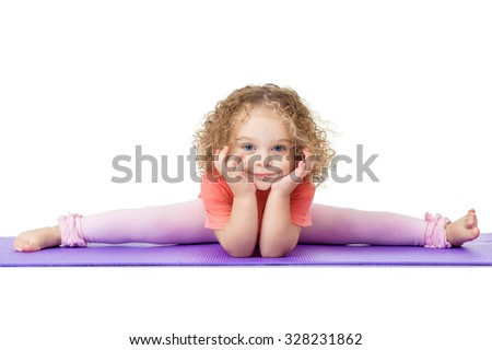 Little girl sitting on the splits