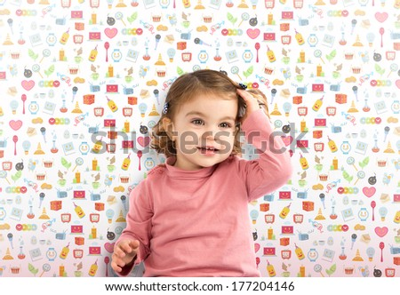 Little girl sitting over cute icons background - stock photo