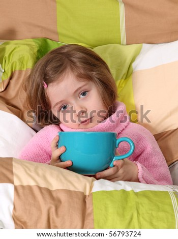 Little girl sitting sick in bed - stock photo