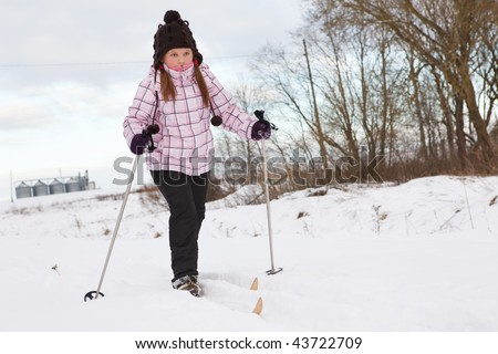 Little girl skiing on cross country skis - stock photo